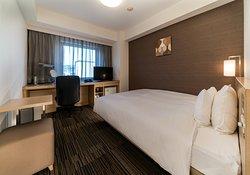 モデレートシングルルーム。 140cm幅ベッド。 18.2平米。
