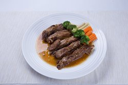 Our famous braised pork ribs served with vegetables