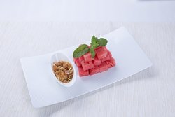 Authentic recipe Thai appetizers with watermelon and traditional dipping sauces