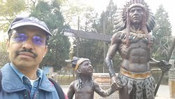 With the Native American Statues
