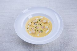 Sweet corn cream soup with potatoes and prawns