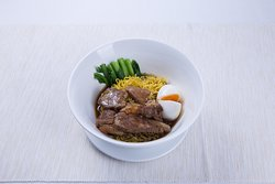 Our famous braised spare ribs served with egg noodles and a soft-boiled egg