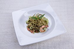 Spaghetti with prawns, squid and homemade pesto