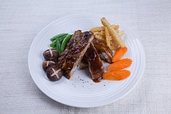 BBQ spare ribs with honey- mustard sauce served with fries and vegetables