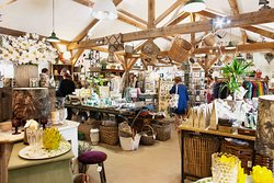 Our garden and gift shop is housed in our wonderful cob building with its high-beamed oak ceiling. The shop décor is an eclectic mix of recycled lighting, unusual old cabinets, dressers and furniture, all creating a relaxed atmosphere and style, highly conducive to browsing and purchasing.  If it is a garden necessity, a birthday or Christmas present, or even a treat for yourself, you'll be sure to find just the thing at the Duchy of Cornwall Nursery.