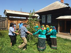 A traditional dance around birch tree during our Siberian countryside experience tour.