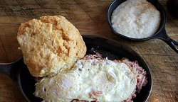 corned beef hash with eggs, amazing grits and biscuit
