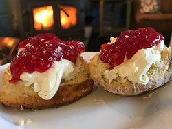 Scones freshly baked every morning with clotted cream and our home made jam.
