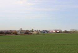 Il se situe sur l'aérodrome de Champforgeuil et le bâtiment est très grand