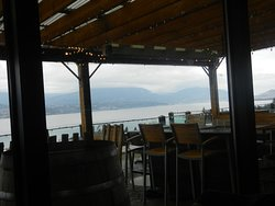 Tables w/ vineyard-lakeside view below..you can eat on the patio in summer!