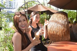 Miss Cosmoworld Cambodia and Miss Cosmoworld Korea enjoying their coffee at the alfresco area