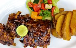 pork spare ribs, glazed with sweet sour tamarind sauce,  organic vegetables salad, hand cut chip potatoes