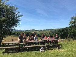 Outdoor dining, a keep fit group staying at the hostel.