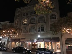 Exterior of The Monterey Hotel in Monterey at night.