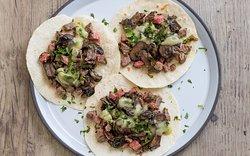 Sharky's Angus Steak & Roasted Mushroom tacos - Rajas, avocado salsa, cheese; organic flour tortilla