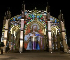 A third view of the lighted facade of the Notre Dame Basilica