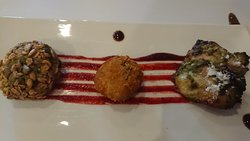 Entree tasting plate per cudo offer L to R Green pea, spinach and granola tikki (vegetarian)  Southern Indian crab cakes Chicken tikka