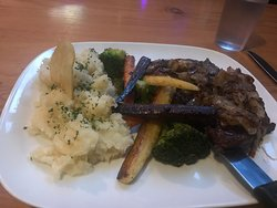 Rib-eye Steak, with veggies, sautéed onions and mashed potatoes