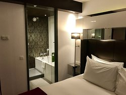 Bed and view of the bathroom.