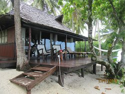 beach suite:  front deck with hammock/chairs and large glass doors where bed faces water