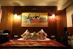 Cozy bed of Kanchenjunga V Room