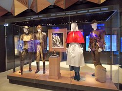 """The uniformed Australian soldiers and nurse display case, beyond which is the """"immersive"""" cinema.  The Sir John Monash Centre at Villers-Bretonneaux, on the Somme."""