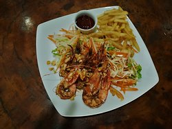 Negombo Prawns Delicately Seasoned and Pan Fried, served with Salad and Fries