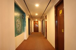 a view of the lobby of the hosteller, jaipur. traditional art displayed on the walls of the lobb