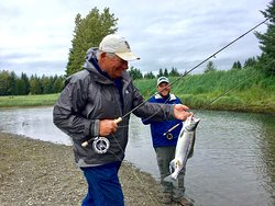 Father and son fish for Pink Salmon on the fly.