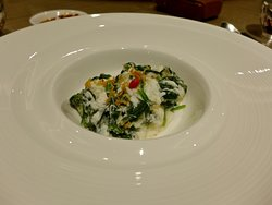 The Wok-fried Seasonal Greens with Egg White and Crispy Conpoy.