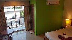 Superior Room with balcony  Rooms are located on the 2nd to 6th floors and features a private balcony with views of Patong City. All Superior room has queen size beds, air conditioning, a cable TV and minibar.  Enjoy fast WiFi, complimentary water, coffee, tea and chocolate drinks while your stay.