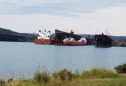 On the left, the Edgar B Speer. 1005 feet long and 105 feet wide the 2nd largest ship on The Lakes only behind the Queen Of The Lakes Paul Tregurtha. On the right the John G Munson, about the same size as the Edmund Fitzgerald in 1975 at 730 feet long and 70 feet wide. Both Lakers are being loaded with Taconite at Two Harbors docks.