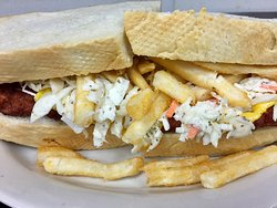 This is our fish sandwich done Pittsburgh style with American Cheese, coleslaw and fries.