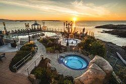 A beautiful sunrise over the Salish Sea and the Boathouse Spa Mineral Baths.