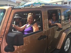 Smiles are always brighter when there's a sun roof in place. Drive in style in the perfect island friendly vehicle: A Jeep Wrangler