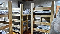 Our Rhino Dorm Room sleeps 6 in 3 double bunks. This room has wifi, air-conditioning and an en-suite bathroom with shower, basin and toilet.
