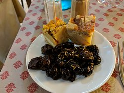 A complimentary serving of olives and an amuse bouche.