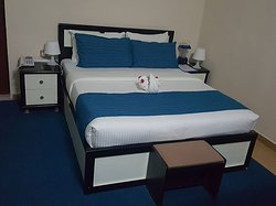 Standard room with en suite bathrooms and tiled floor. All rooms have Air condition,equipped with dressing table, TV's, plug in point and wireless internet access and satellite