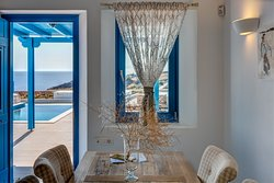 """Dining room area, one bedroom Suite  """"en suite"""" terrace and pool. Fully Autonomous and bio climatic villas, Minimal design with traditional twists."""