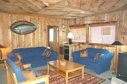 Our cool and rustic cabins all have a common area shared space that is great to relax and tell fishing stories of the day.