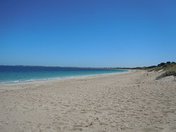 Warnbro Beach, near Rockingham. Wonderful stretch of clean sand with warm Indian ocean waters. Can be windy in the afternoon so go early. Official 'clothes optional' section is certainly worth a visit