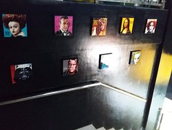 Photo frames along the stair case.