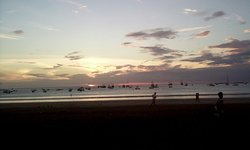 sunset from San Juan Del Sur, Nicaragua.  close to the beach volleyball courts.