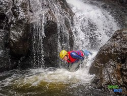 Sliding out from the plunge pool of the main waterfall - Afon Ddu