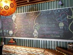 Wall menu featuring baked goods