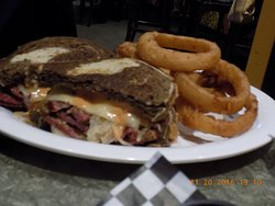 Reuben YUM /Onion Rings UGH picture is decieving