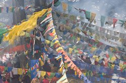 Prayer flag in the smoke of offering.