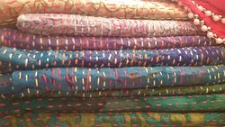 traditional kantha craft scarfs with line stitch by indian village women.