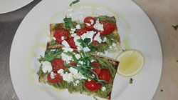 Smashed avocado W/ chermoula/goat feta/cherry tomato/basil olive oil veg