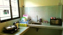 Cooking area is small, but fully equipped with electrical stove, oven, cookware, and utensil.